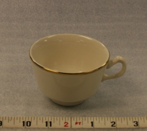 "Ivory and Gold Cup Height 2 1/2""  Width 3 3/4""  Volume 6 oz. $0.70"