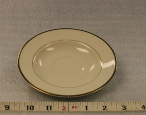 "Ivory and Gold Saucer   Height 1""  Width 5 3/4""  $0.70"