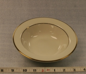 "Ivory and Gold Soup Plate   Height 2""  Width 7""  $0.70"