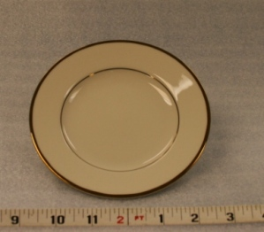 "Ivory and Gold Bread and Butter Plate Height 5/8""  Width 5 3/4"" $0.70"