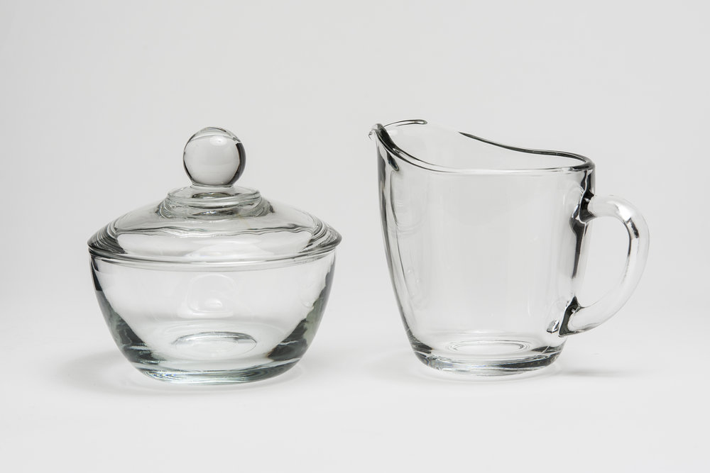 "Clear Sugar and Creamer 8 oz.   Height 4"" Width 4"" and 5"" including handle     $1.30/set"
