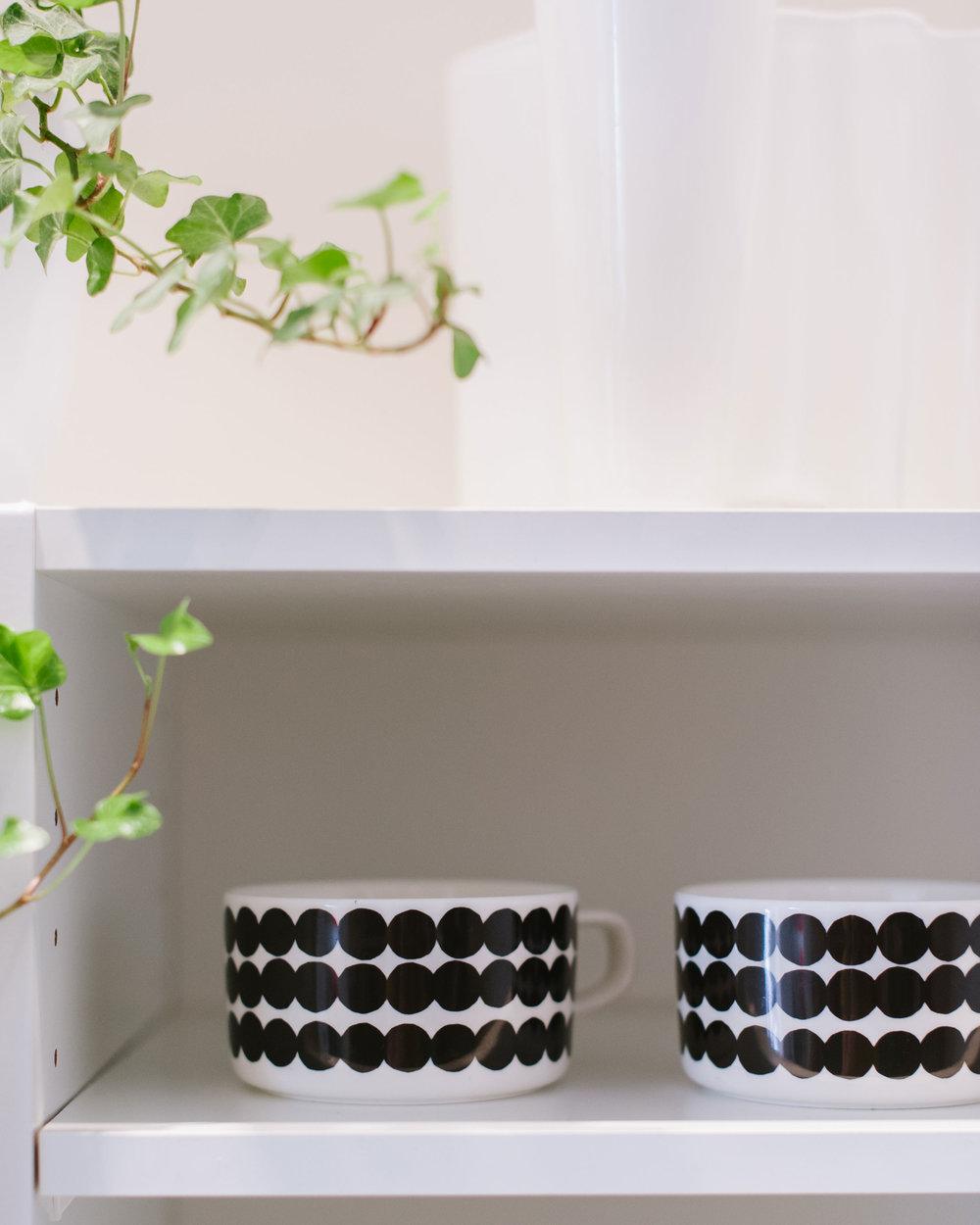 Aalto-vase-and-Marimekko-mugs-in-kitchen-cupboard.jpg