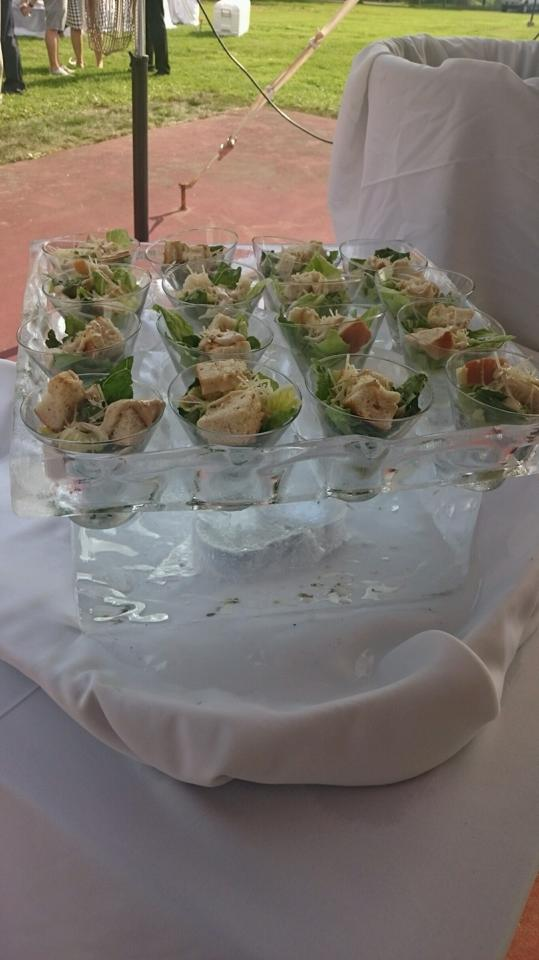 Caesar Salads served in stemless martini glasses by - Valley Catering  Ice Sculpture to hold the Caesar Salads by - Tyson Whistler