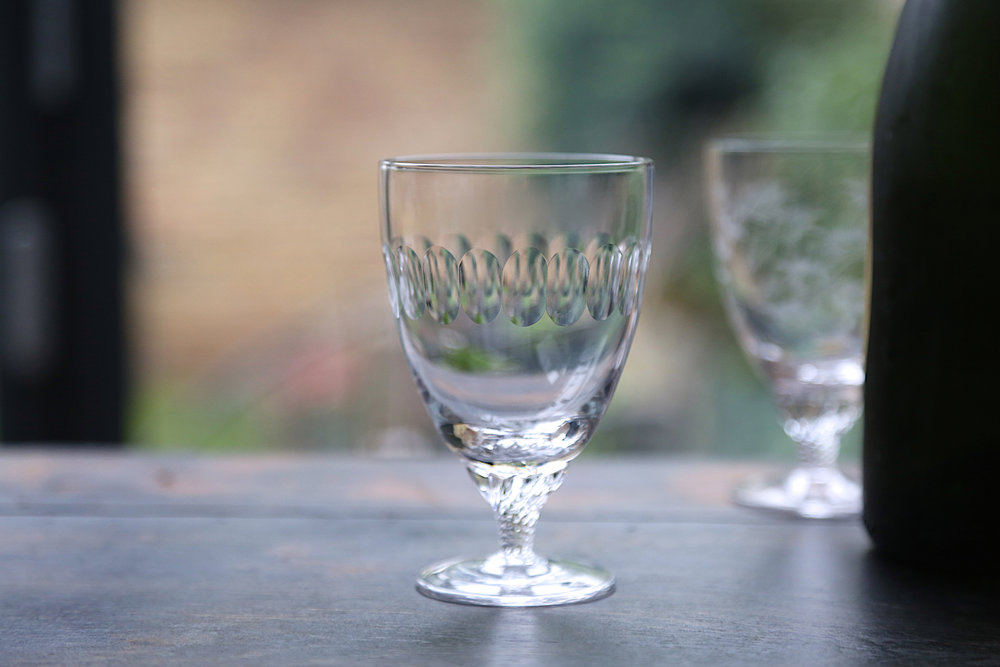 BISTRO WINE  GLASSES   With short, twisted stem, this is a classic French design. 12cm tall; 7.7cm wide; capacity 225 ml