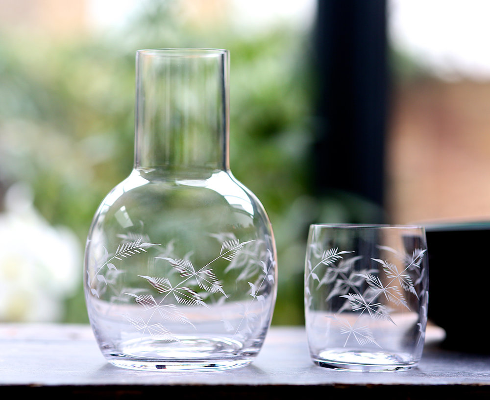 CARAFES   With accompanying glass, the carafe is perfect for bedside tables. Carafe: 20 cm tall, 12.5 cm wide, capacity: 1300 ml; Glass: 9 cm tall, 7.2 cm wide at rim, capacity: 270 ml