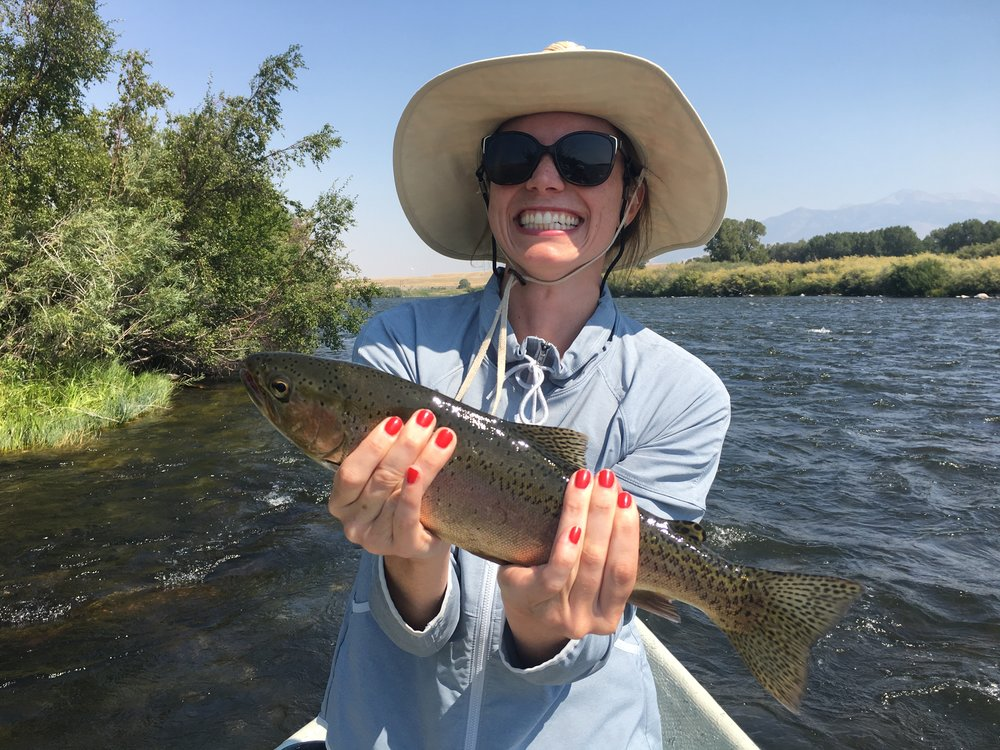 Kelly from Washington D.C. with her first big Rainbow caught on a dry fly