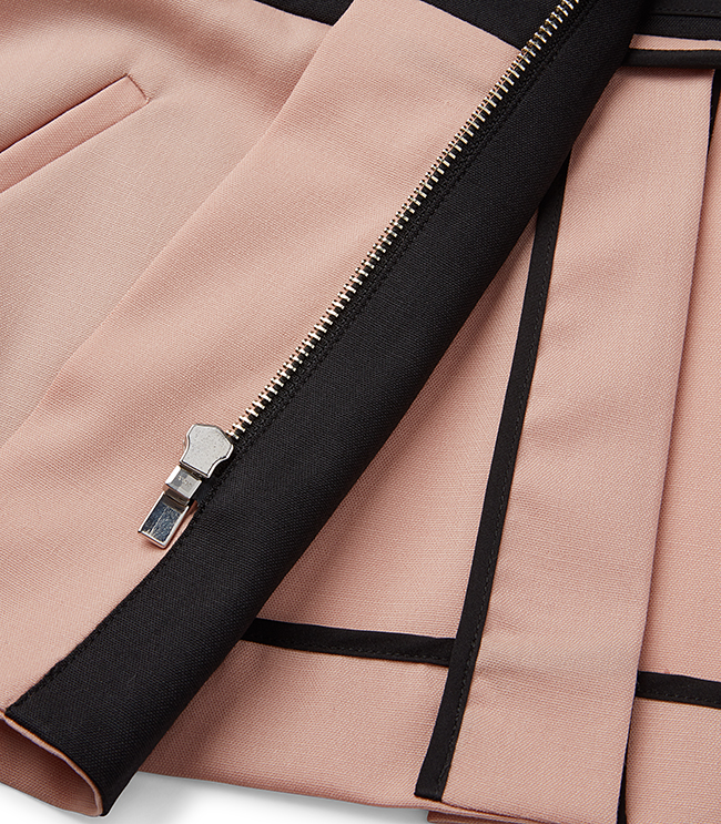Arias New York  uses one product shot to show both the stitching and lining of a jacket