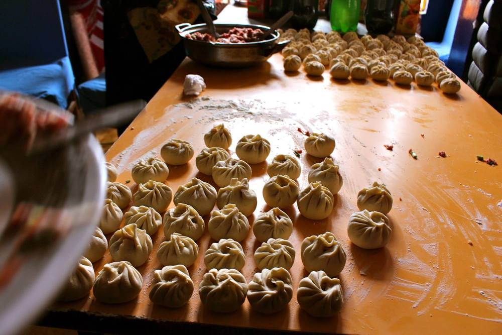Making dumplings for Losar (Tibetan New Year) with other people from Amdo region, in Dharamsala, India.