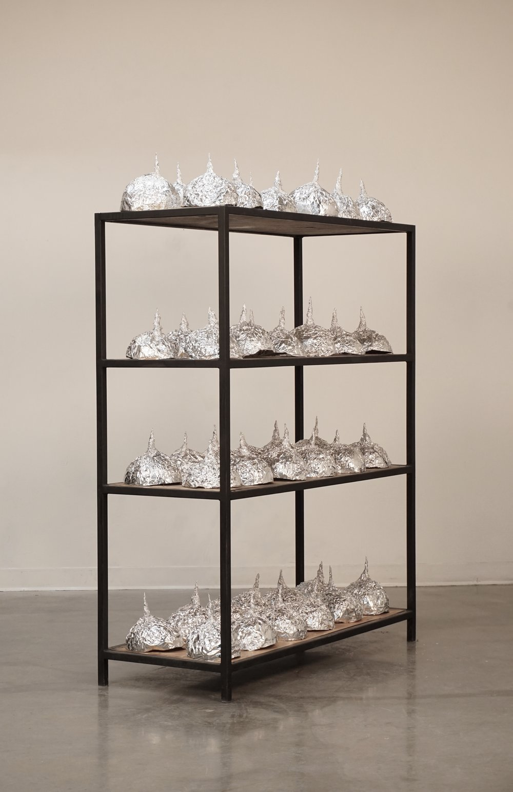 tin foil hats sculpture conspiracy theory lukas liese.jpg