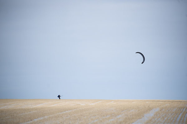 Jason Magness snow kiting across North Dakota fields