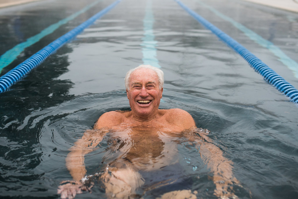 Klaus Obermeyer flashing a smile whiles swimming laps at the Aspen Meadows Resort in Aspen, CO