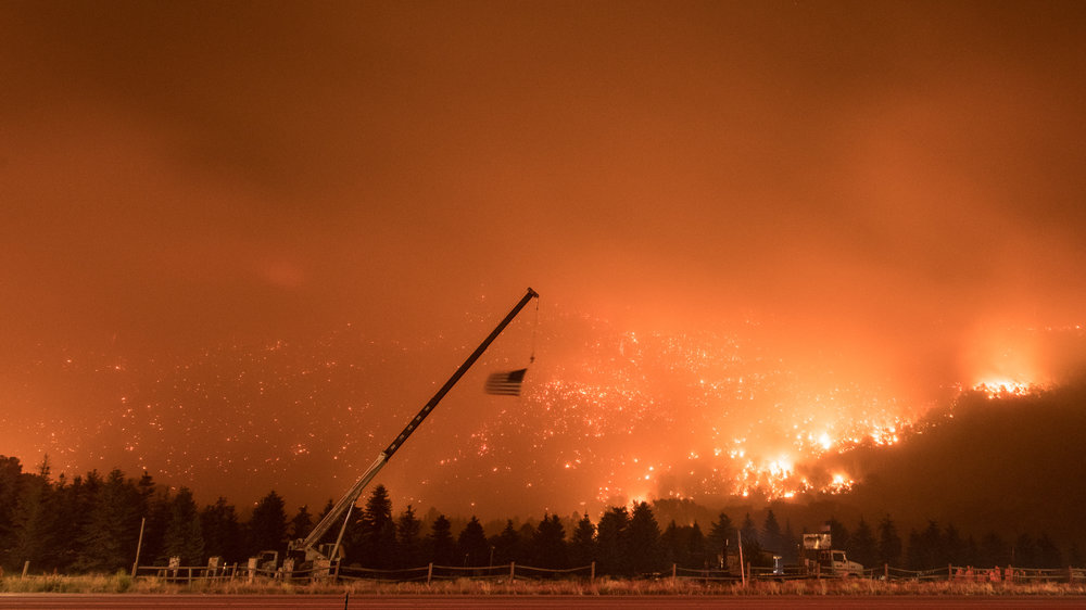 An American flag blows in the wind on July 4th, 2018 during the Lake Christine fire.