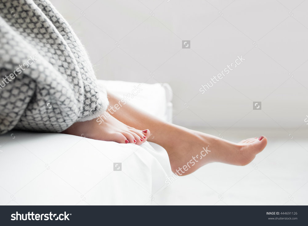 stock-photo-woman-body-legs-bed-awaking-morning-step-female-foot-sleep-relax-concept-444691126.jpg