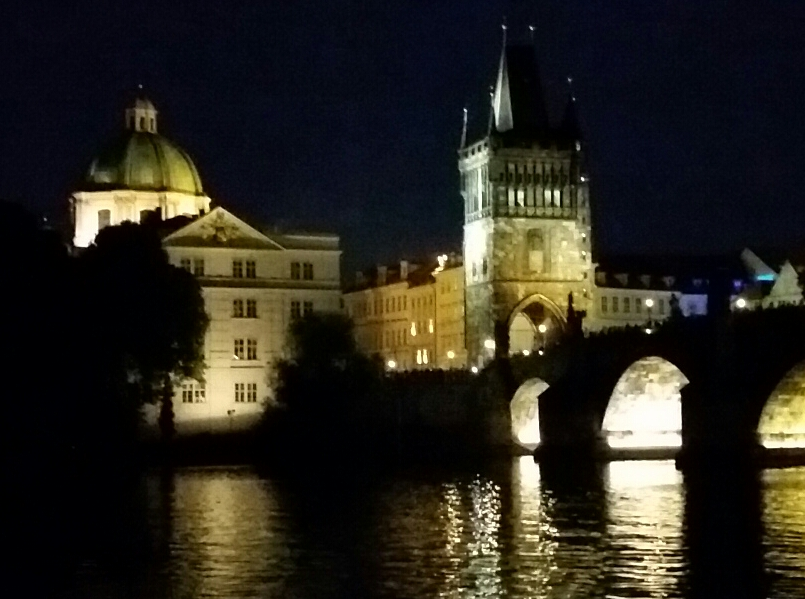 The Charles Bridge at night.  A tourist attraction since the 1300s.