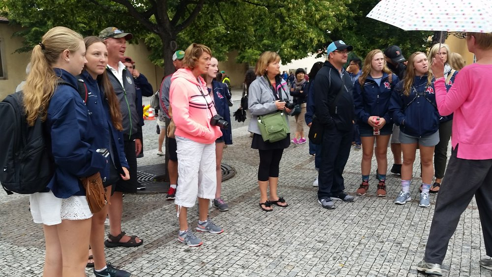 Boston Team Blue members with parents during walking tour of Prague