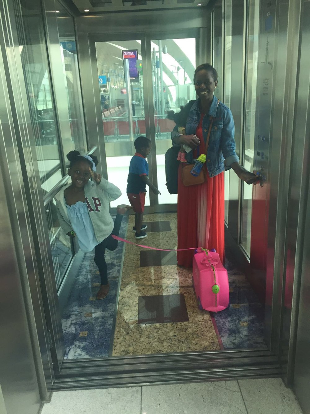 Look at the joy on that face as she drags her trunki! We were in transit, leaving Dubai for Harare here.