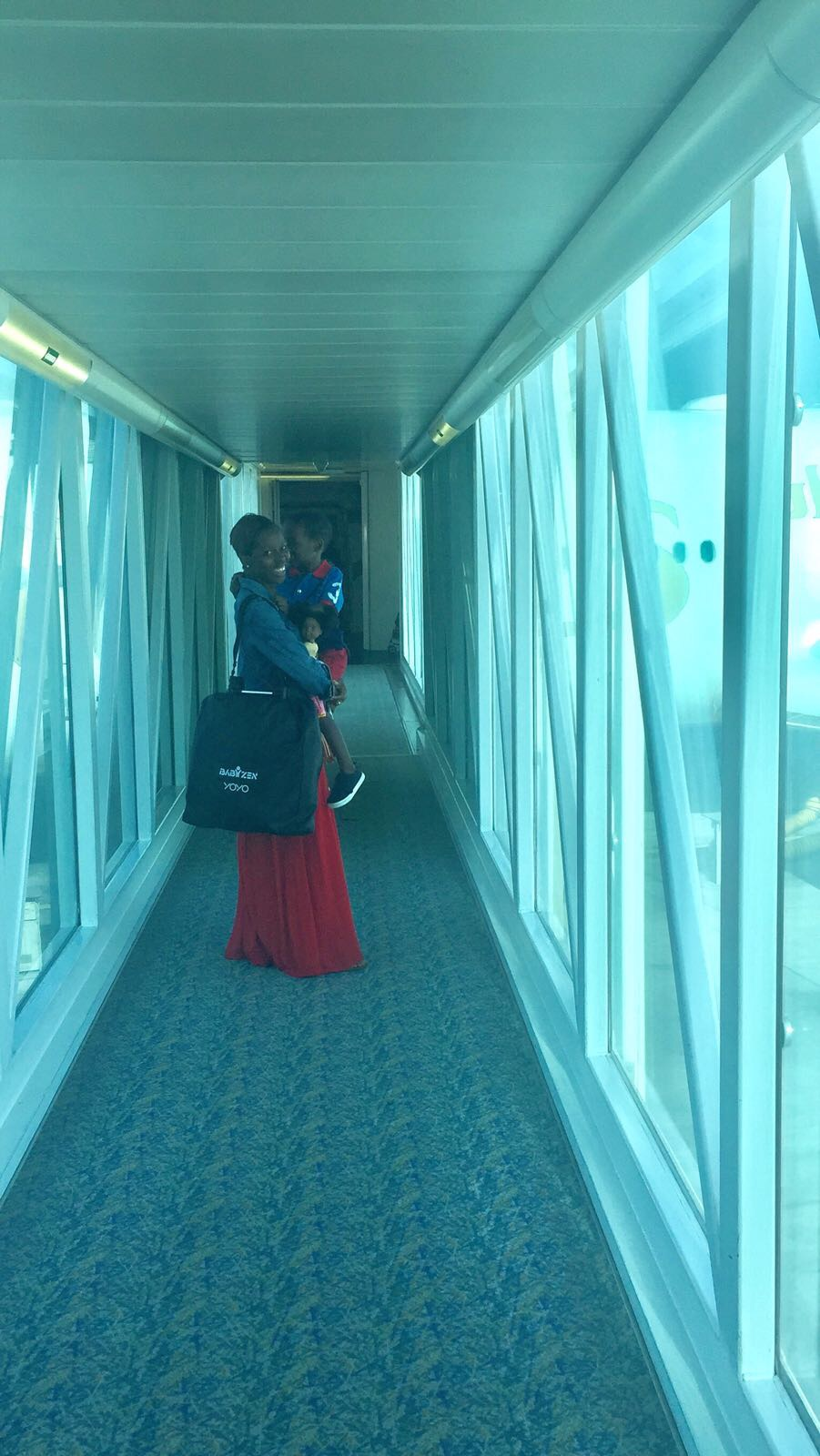 sorry for the fuzzy pic, but thats the buggy all folded up and me carrying it onto the plane :)