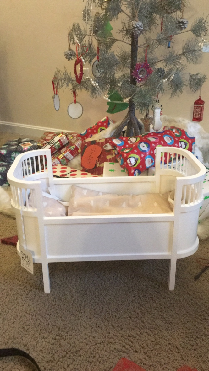her cute new  dolls crib , complete with bedding!