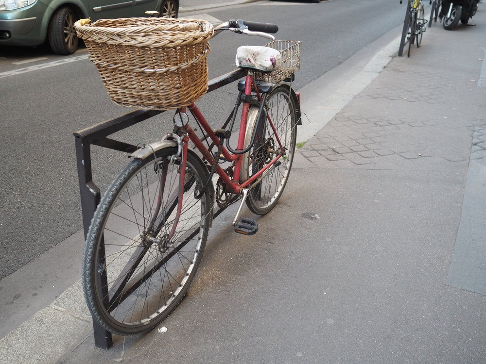 bike with basket in the middle of Paris…all that's missing is me on the seat with a beret, hydrangeas and red lipstick