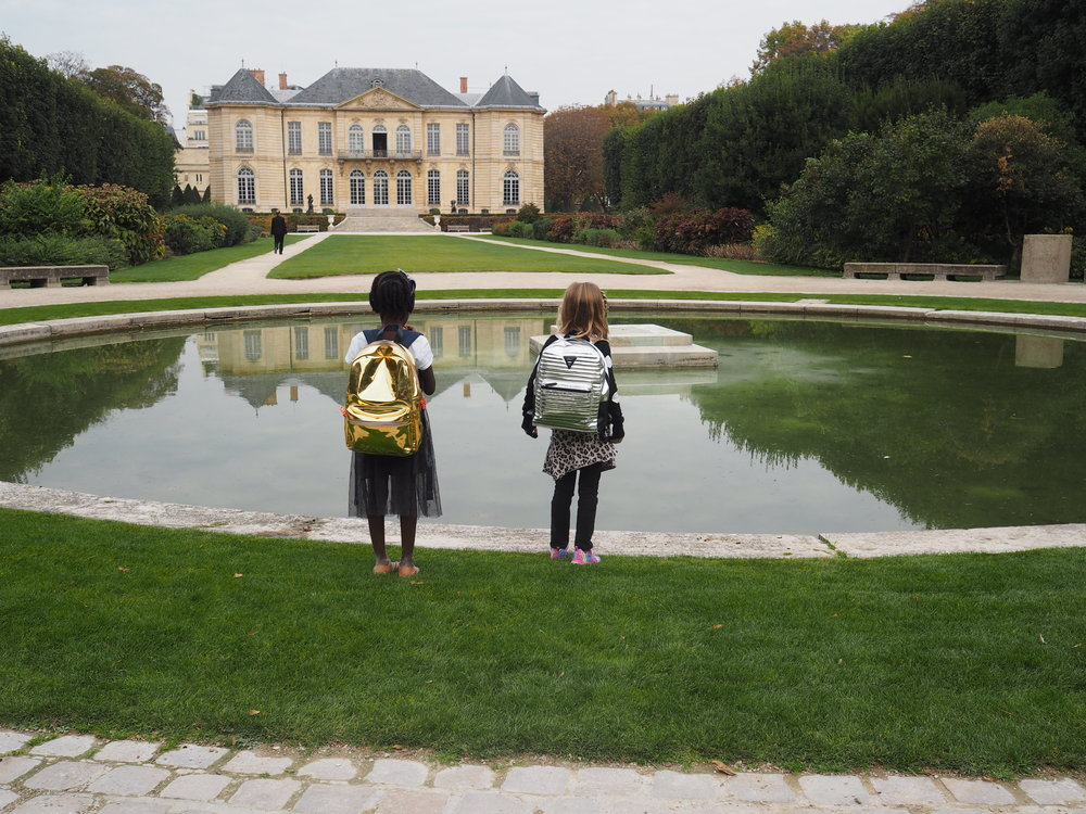 these two. I love any picture with them and their backpacks.  meanwhile…can you imagine this being your home & back garden? sigh. someone once called this place home.