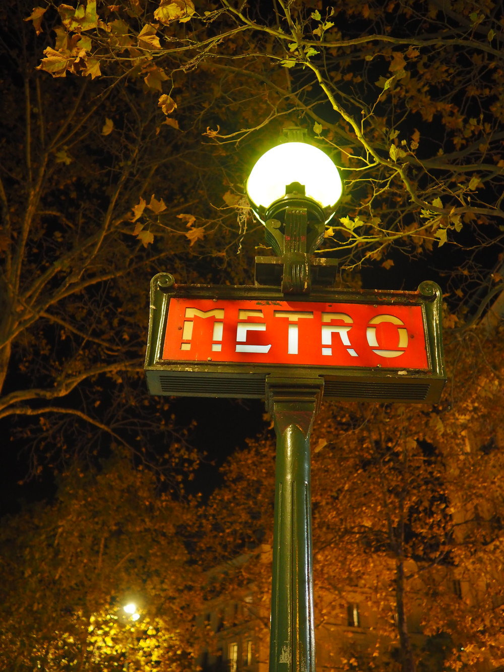 sigh. the metro sign by night.