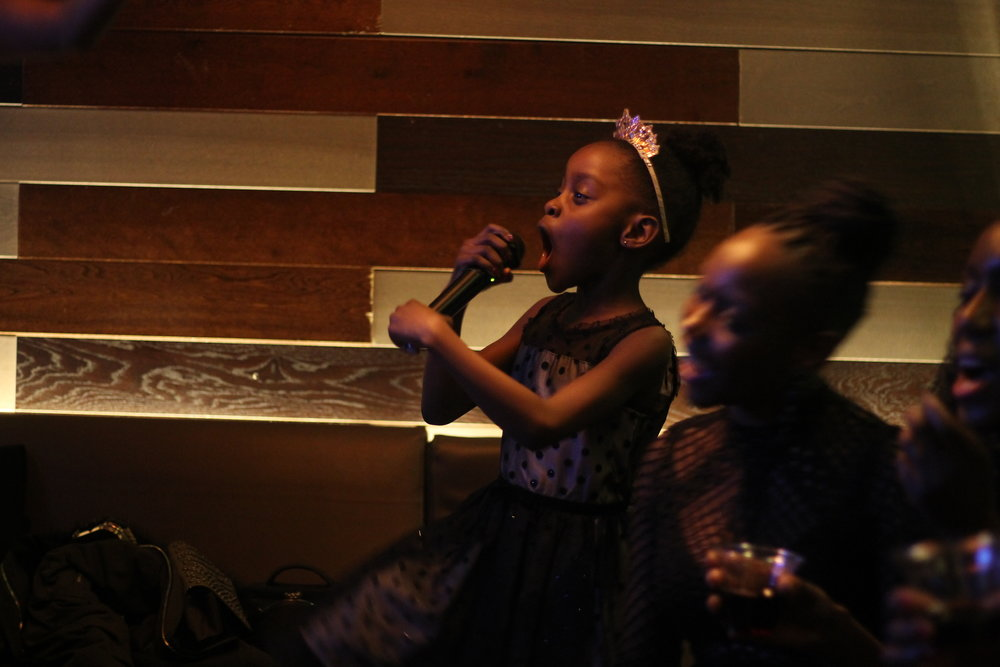 This is the girl who had claimed she might not sing at the karaoke because she was shy….she hogged the mic more than me! haha!