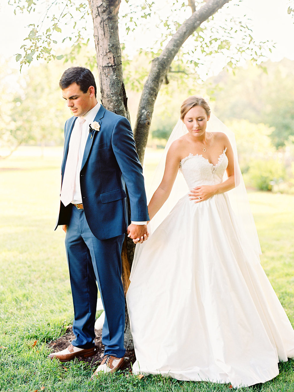 Sydney and Jamie pray together before their ceremony at  Fearrington Village  |  Nancy Ray Photography
