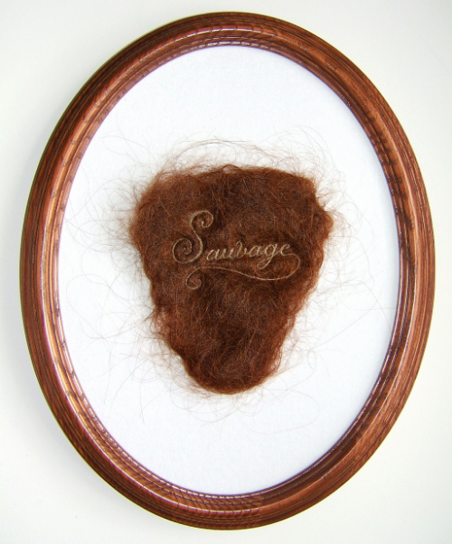 """Sauvage"", 2013, human hair embroidery on hair, velvet, 7 x 4"" piece, 12 x 9"" framed. Image via Kate Kretz"