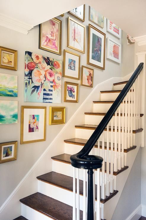 A lovely art wall gives this staircase personality  Photo courtesy of Pinterest