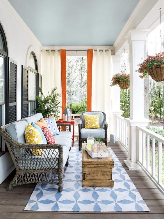 This patio , done up in blue adds a little drama with the sky blue painted ceiling.