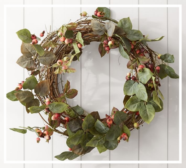 Add a wreath to the front door to welcome guests! This 'Rosehips Wreath' from Pottery Barn is simple and elegant