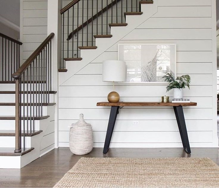 Shiplap featured on a staircase. Courtesy of Pinterest