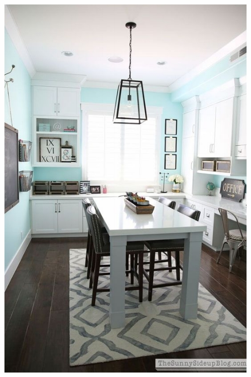 This creative space plays double duty in being a craft room and a space to use as a home office. Photo courtesy of Pinterest