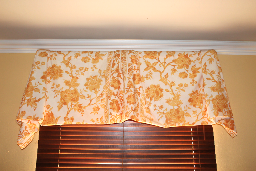 No Sew Valance over wood verticals. Fabric folded, pleated and stapled onto a wooden rod.