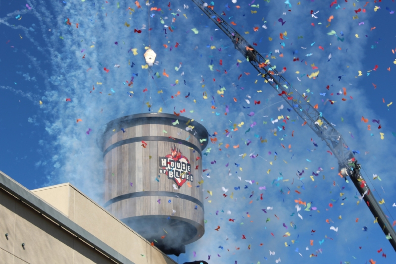 The iconic water tower ceremoniously being placed upon the roof of the soon to open HoB at The Anaheim Gardenwalk