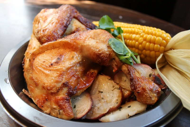 Lemon Roasted Chicken from Three Broomsticks. They also have a rib plate with same sides. Both are delish and great for sharing, cause that's half a chicken!