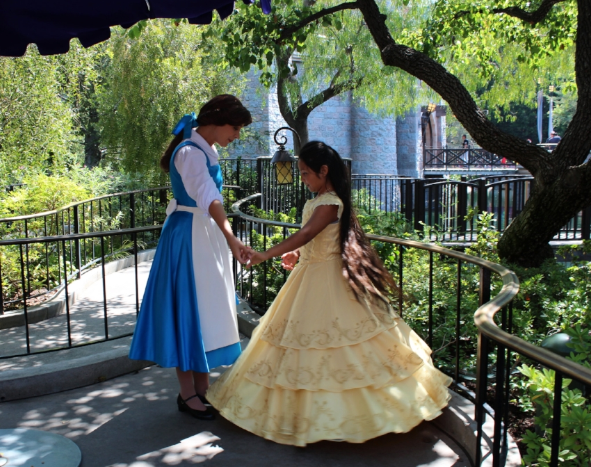 My daughter with Belle in her Chasing Fireflies Dress, she still loves dressing up for her visits.