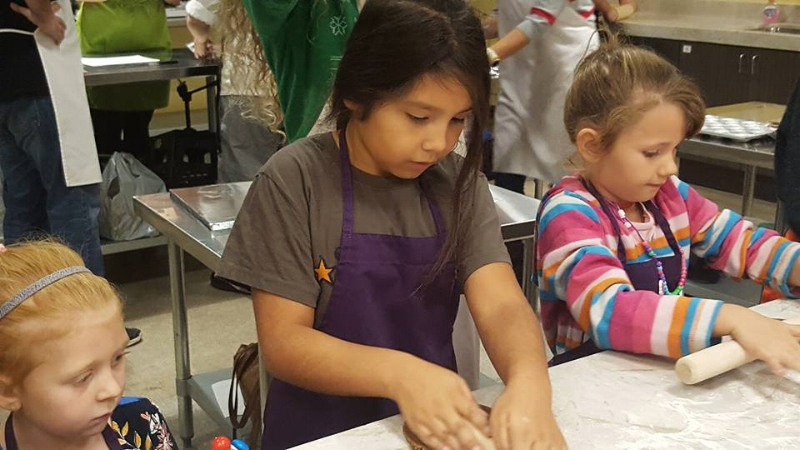 Rolling our some gingerbread cookies at the Discovery Cube