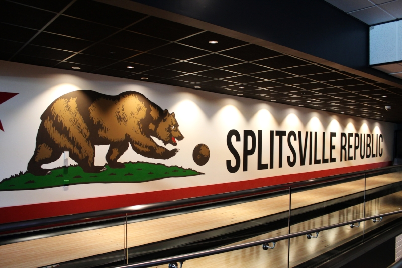 Hand painted murals with a California theme at Splitsville Luxury Lanes Anaheim