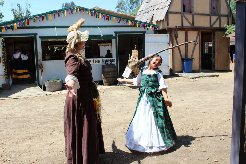 Ha! balancing and walking with a broom on your head, yeah it's a thing at the Festival.