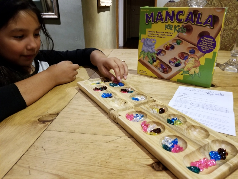 Mancala was new even to me, simple search on Youtube and we were on our way! This one is also good for fine motor skills. Handling several pieces and dropping them into their spaces one at a time with the same hand proved to be a bit challenging for my girl.