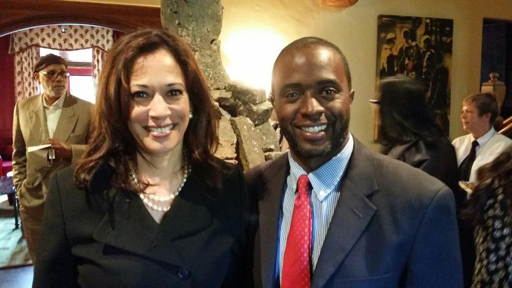 California State Assembly member Tony Thurmond poses with California Attorney General Kamala Harris, who recently sponsored a truancy prevention bill.