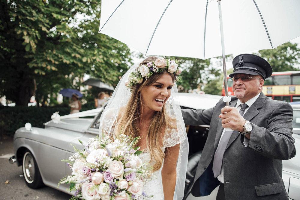Happy Bride on her Rainy Wedding day