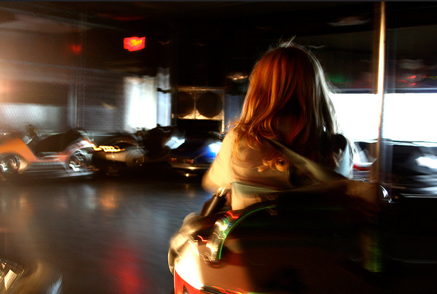 teen on bumper car