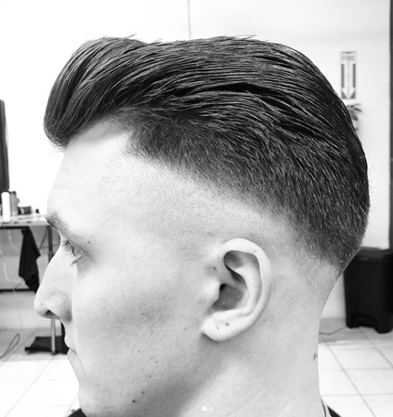 Textured Quiff + Low Fade and Part - This is a new look that is starting to get some attention, and that you will. With a tight fade on the sides. This is like a Pompadour but instead of every hair strand perfectly combed. you break it but running your fingers through the long top hair. giving it some texture.Book Now!