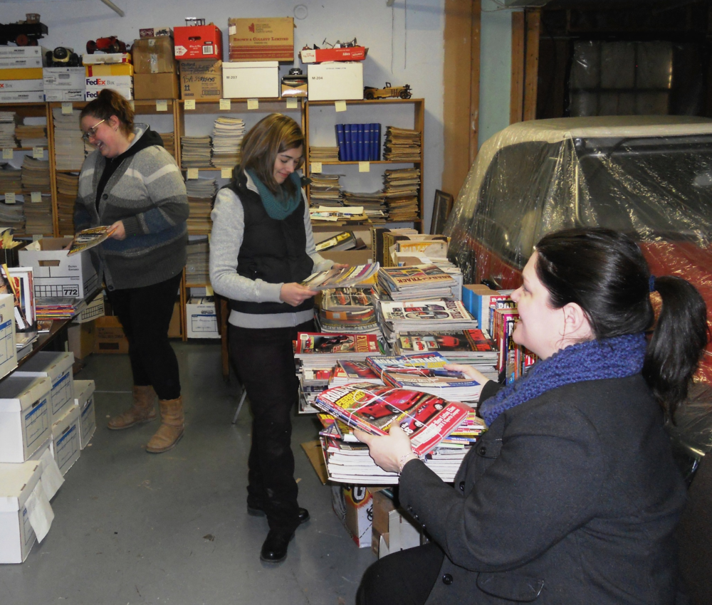 The Canadian Automotive Museum's library team sorting magazines.