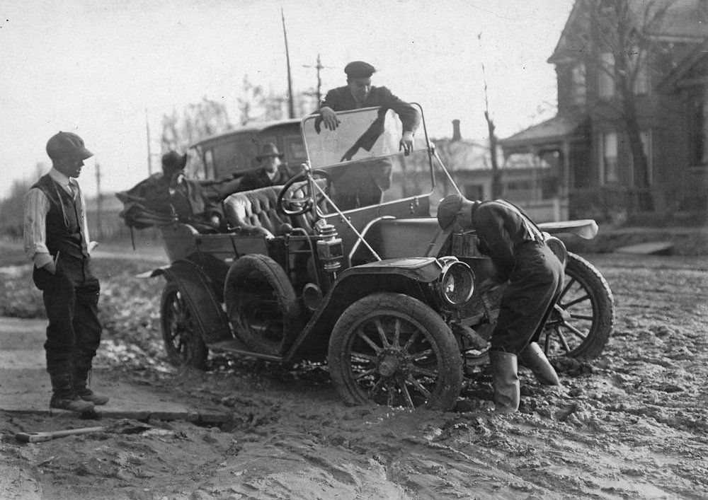 Paved roadways were constructed to allow vehicles to travel with ease. Before this, however, cars would often get stuck or break down in the muddy, unpaved streets, like this one in Toronto in 1913.  City of Toronto Archives, fonds 1244 item 42.