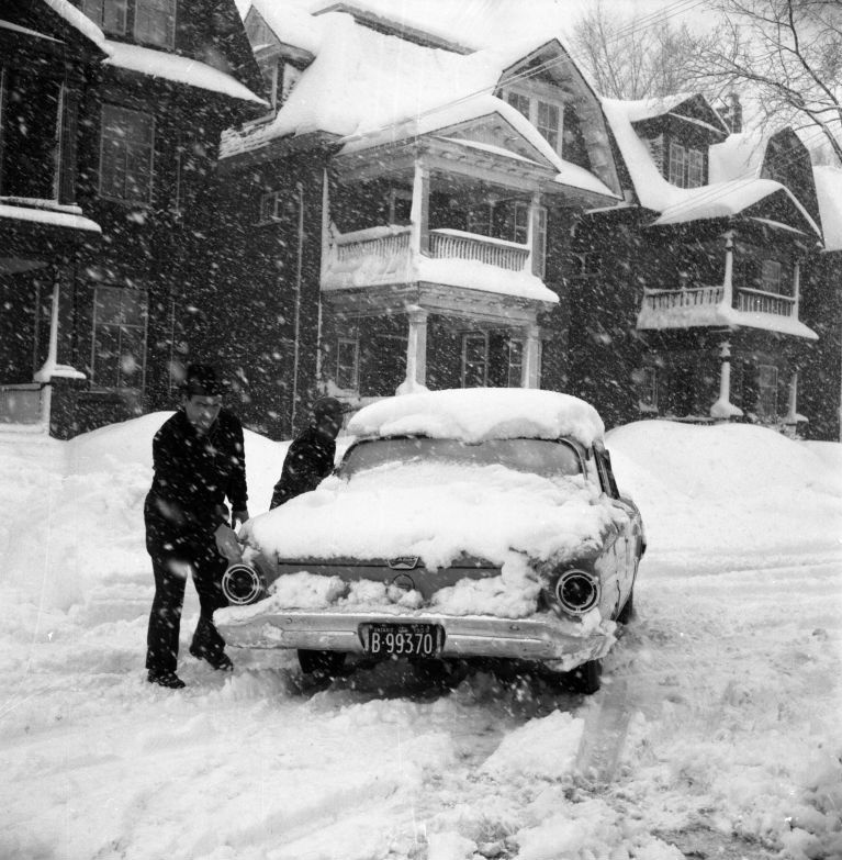 For nearly half the year, driving in Canada faces the threat of snow and ice. Cleaning snow off a car in Ottawa, Ontario., 1959 . Library and Archives Canada/Rosemary Gilliat Eaton fonds/e010977876.