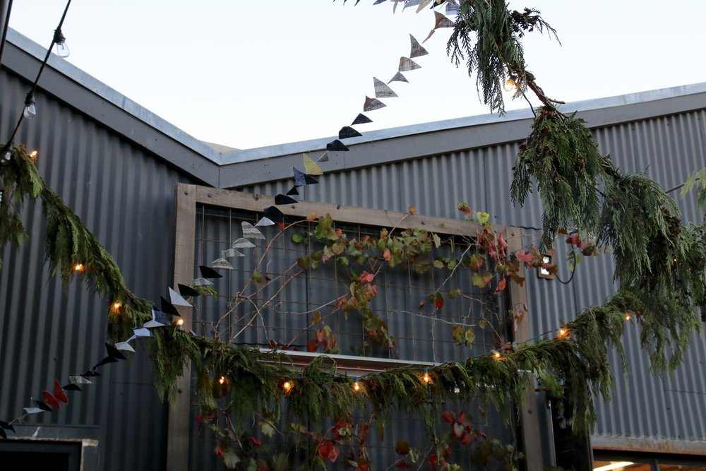 The courtyard at Potek Winery looking festive with our linen garland and greenery by Ella & Louie.
