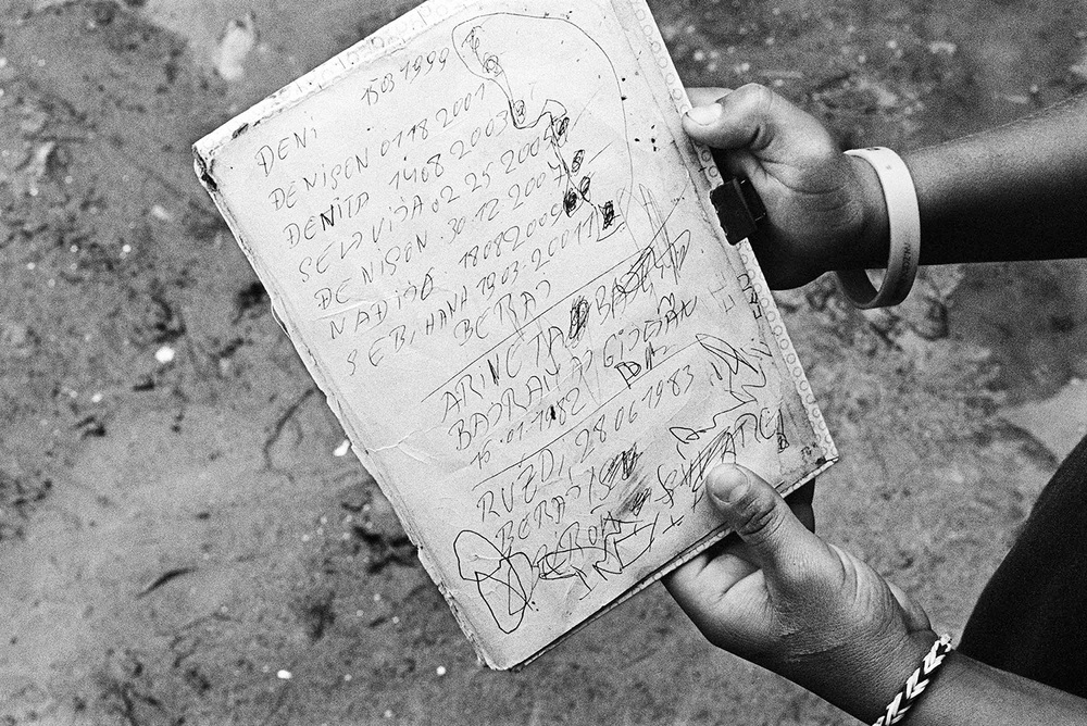 This 15-year-old holds a folder of paper that contains the names and dates of birth for he and his six brothers and sisters. He was born to a Roma family that fled from Kosovo to Serbia in 1999. All of the children in his family are legally invisible. The only record of their date of birth is this piece of paper hand written by his father, who passed away in 2012. Due to a number of reasons, many Roma children are unable to be properly registered at birth.
